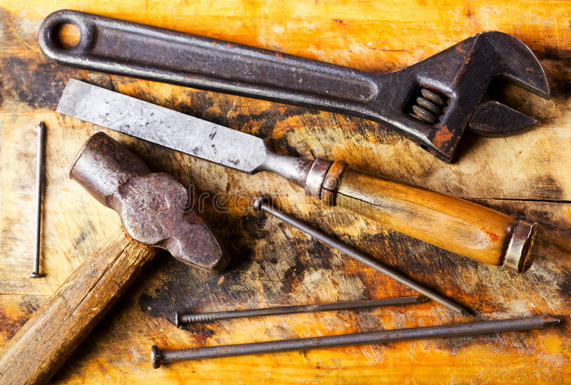 Old tools. On a wooden background royalty free stock photography