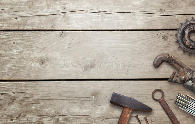 Old tools on wooden table with free space for text. Traditional handmade tools for craftsmen royalty free stock images