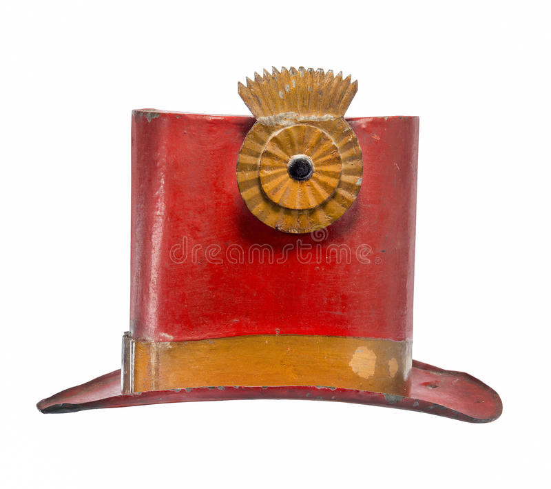 Old top hat metal painted red isolated. Old antique metal top hat painted red made for circus isolated on white stock image