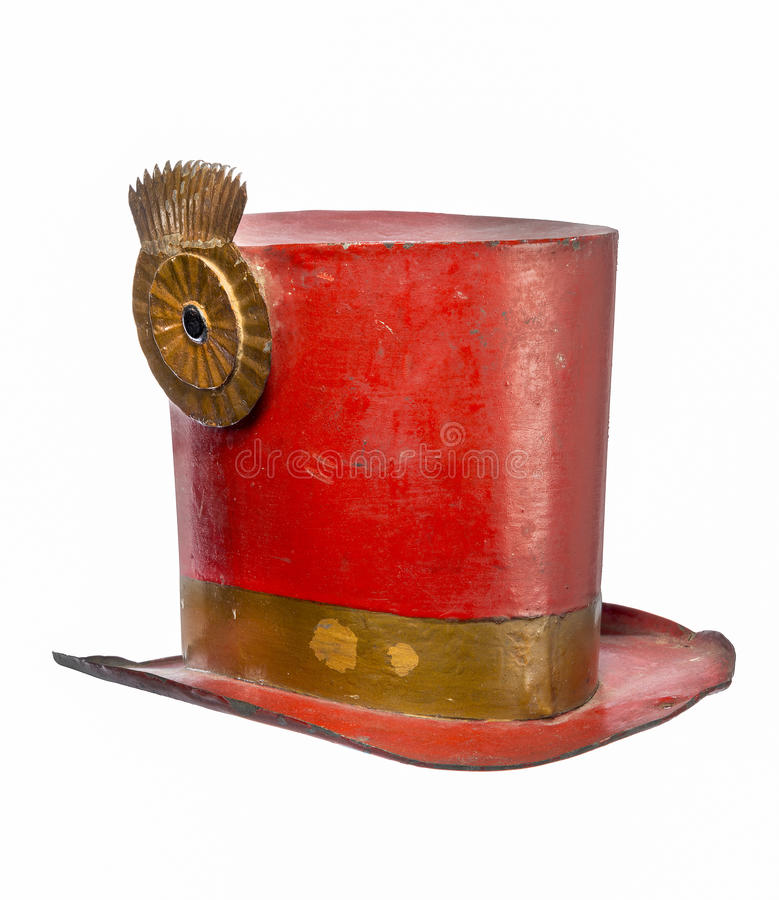 Old top hat metal painted red isolated. Old antique metal top hat painted red made for circus isolated on white stock photos