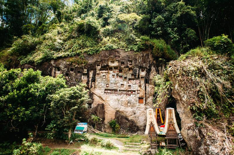 Old torajan burial site in Lemo, Tana Toraja, Sulawesi, Indonesia. The cemetery with coffins placed in caves. Old torajan burial site in Lemo, Tana Toraja. The royalty free stock images