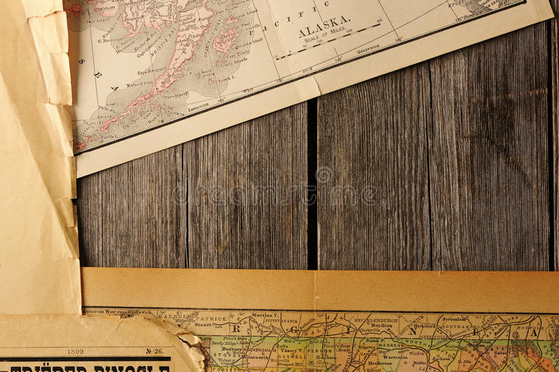 Old torn paper and maps on the background royalty free stock photos