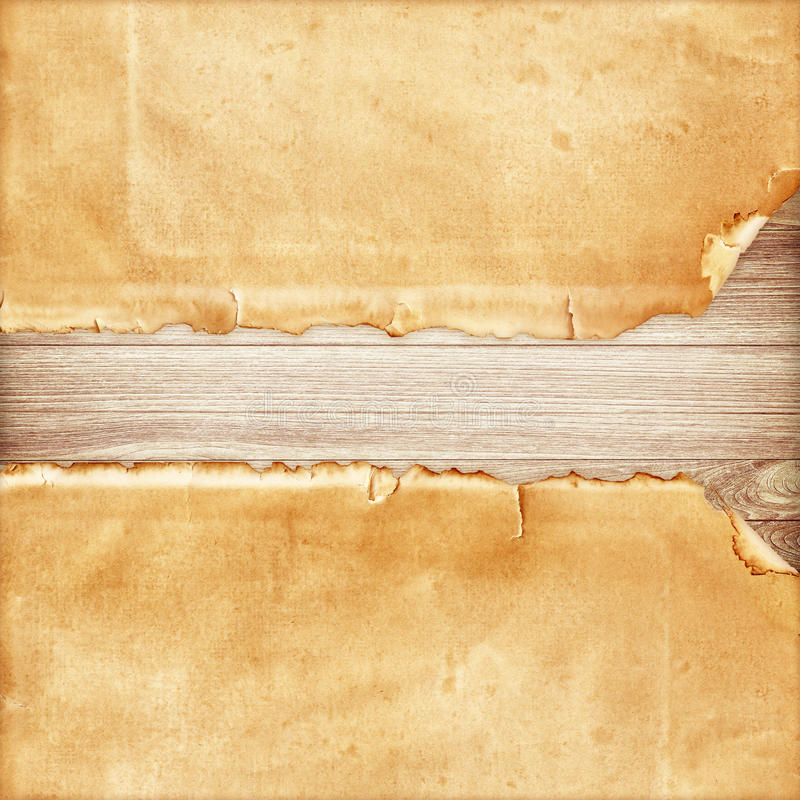 Old torn paper on wood stock image