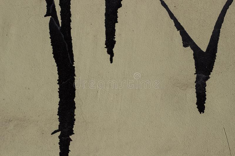 Old torn posters paper on plaster wall background.  stock photo