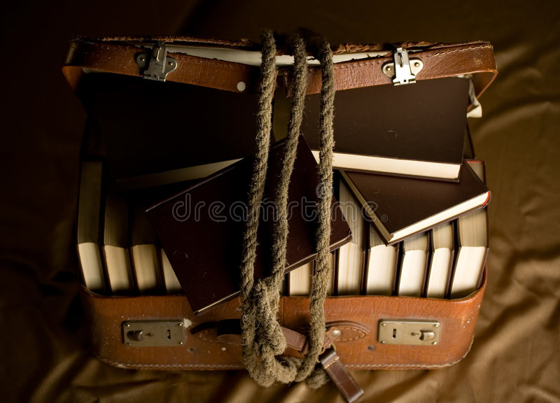 Old torn suitcase full of books royalty free stock images