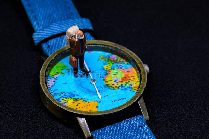 Old tourist in backpack and world map watches. Around world travel photo banner. stock photography