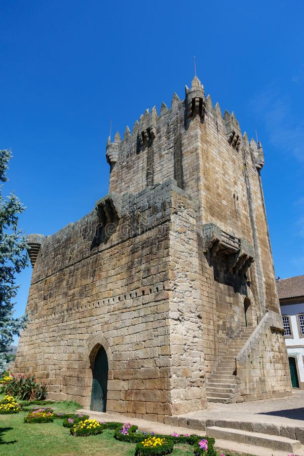 Old tower and castle in Chaves bottom view, Portugal. Bottom wide angle view of old tower and castle in Chaves, Portugal royalty free stock image