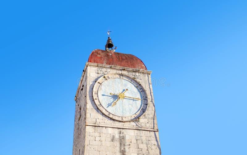 Old tower with a clock. Old tower with a clock and golden arrows stock photography
