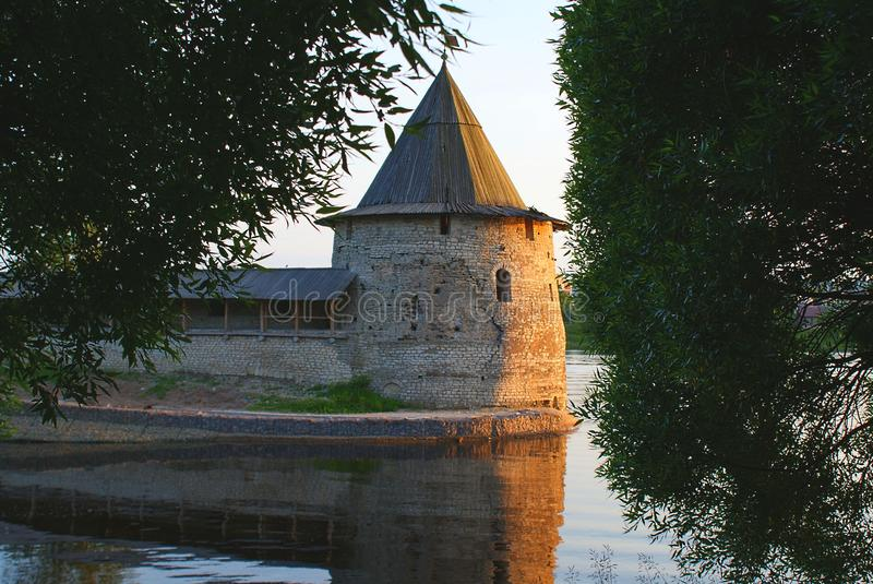 Old tower on the lake stock photography