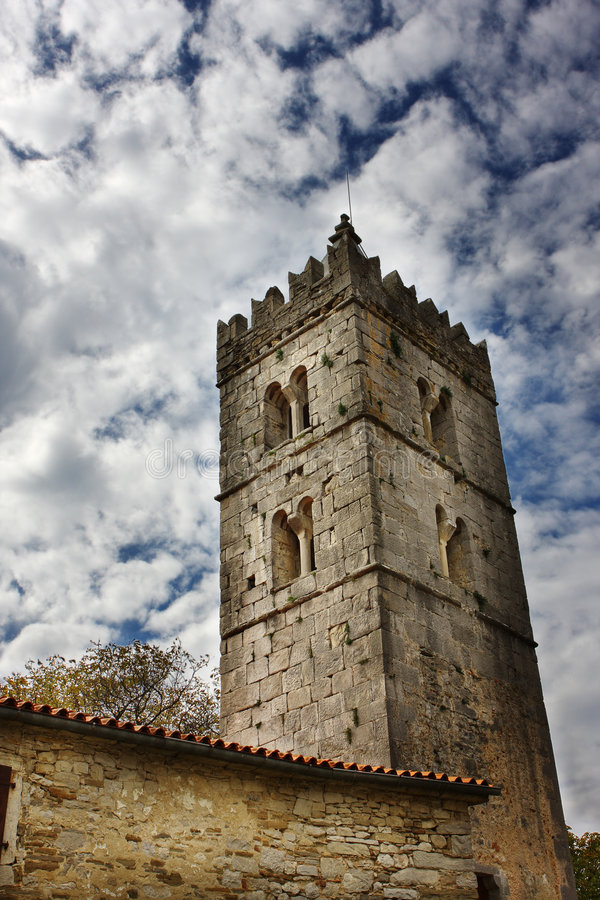 Old tower near a house stock photography