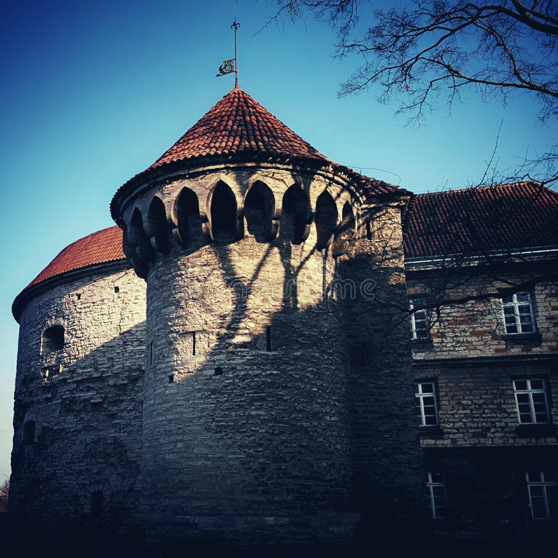 Old tower in old Town with shadow. In old Tallinn at sunny day big tower royalty free stock image