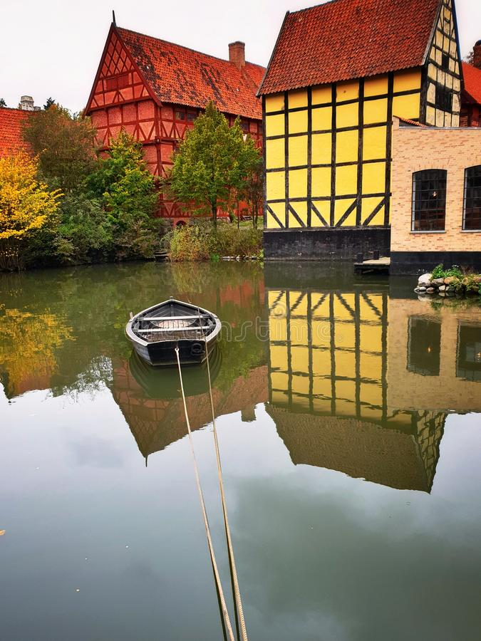 The old town in Aarhus, Denmark - calm lake with boat stock photos