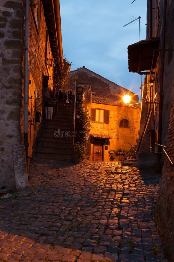 The Old Town Of Anguillara Sabazia, Italy. Evening in an empty street of the old town of Anguillara Sabazia, Lazio, Italy royalty free stock image