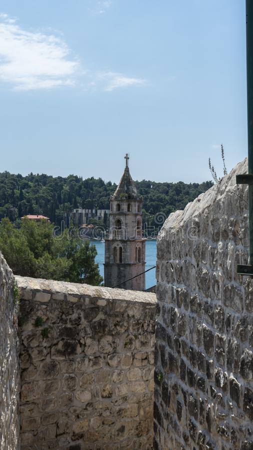 Old town bell tower sea view. Cavtat small coast village. Summer area with narrow stone streets and forest. Croatia resort. History, travel, architecture stock images