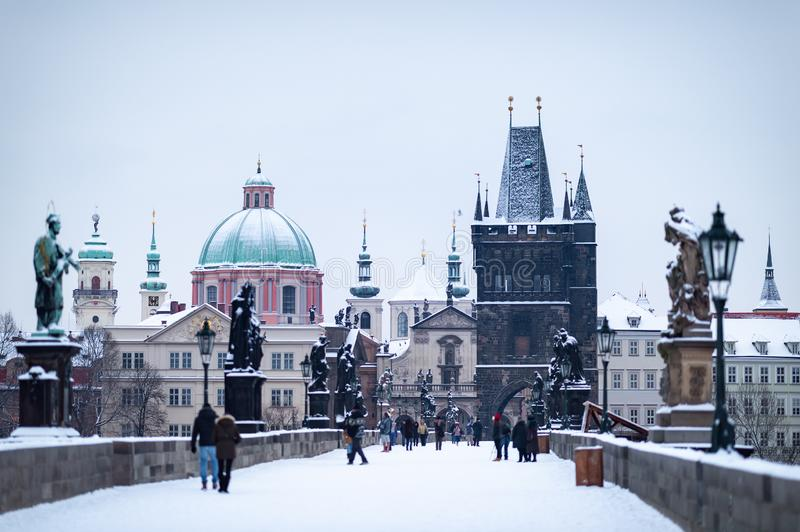 Old Town Bridge Tower by the famous Charles Bridge. The city of Prague covered with snow royalty free stock photo