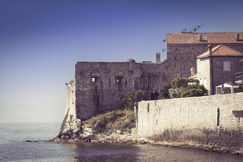 Old Town Budva, Montenegro. The view at the medieval citadel and the old town of Budva. Soft focus stock image