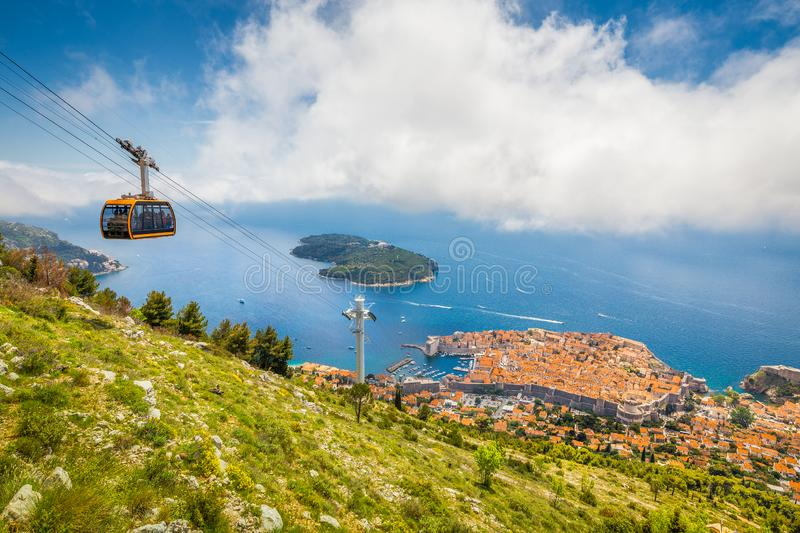 Old town of Dubrovnik with cable car ascending Srd mountain, Dalmatia, Croatia. Aerial panoramic view of the old town of Dubrovnik with famous Cable Car on Srd stock images