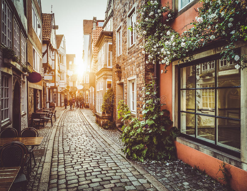 Old town in Europe at sunset with retro vintage filter effect. Old town in Europe at sunset with retro vintage Instagram style filter and lens flare effect royalty free stock images