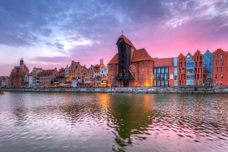 Old town of Gdansk with historic Port crane over Motlawa river at sunset, Poland. City, water, europe, travel, architecture, building, reflection, tourism royalty free stock images