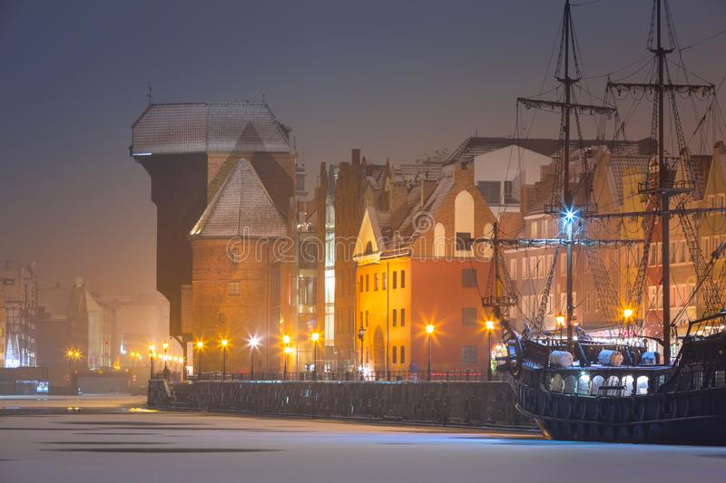 Old town of Gdansk over Motlawa river at snowy winter, Poland. City beautiful port night landscape blue dusk crane dawn polish light travel architecture tourism stock photography