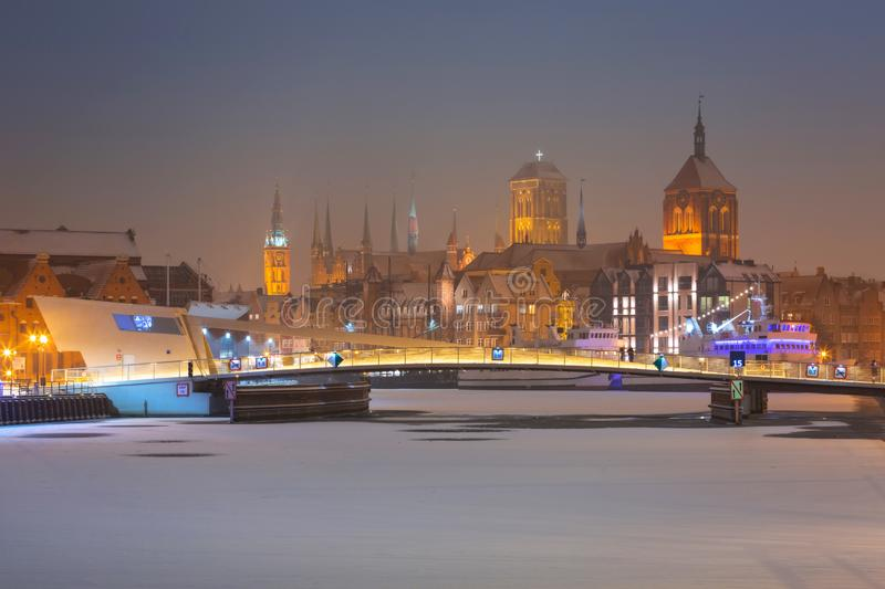 Old town of Gdansk over Motlawa river at snowy winter, Poland. City beautiful port night landscape blue dusk crane dawn polish light travel architecture tourism royalty free stock photos