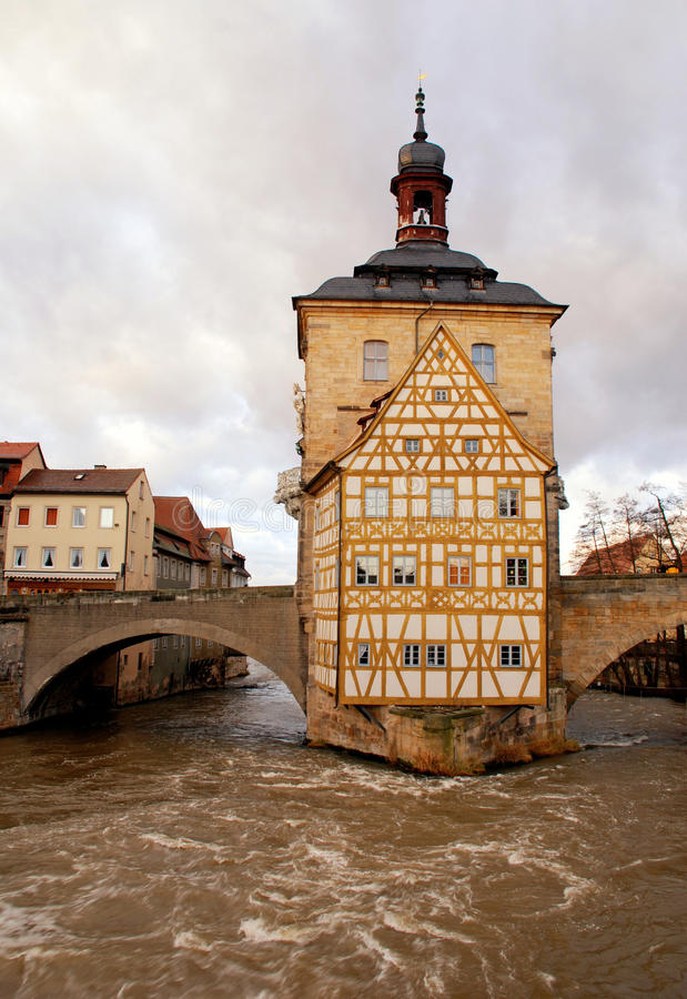 The Old Town Hall in Bamberg(Germany) in winter. The Old Town Hall (1386) of Bamberg(Germany) was built in the middle of the Regnitz river, accessible by two royalty free stock images
