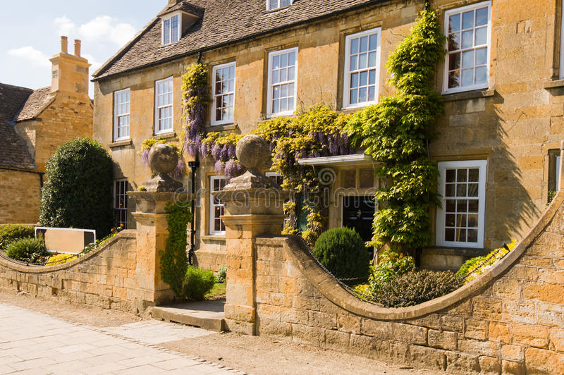 Old town house. With wisteria. Broadway high street. Cotswolds, Worcestershire, UK royalty free stock photos