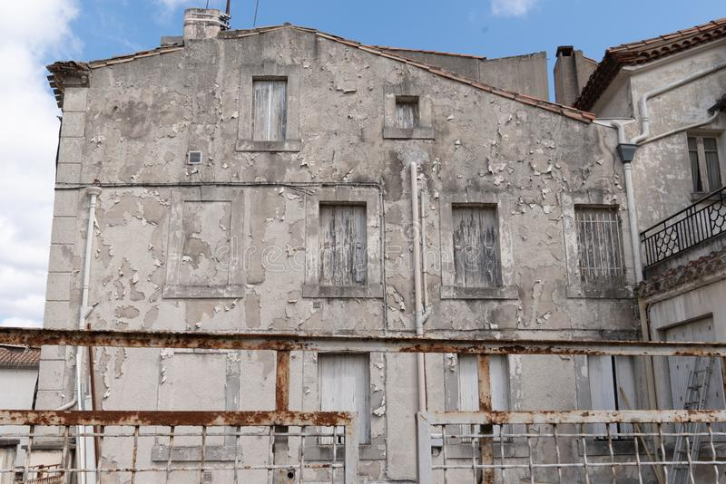 Old town house with worn and old-fashioned paint stock photo