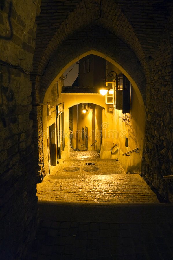 Old town illuminated alley royalty free stock image