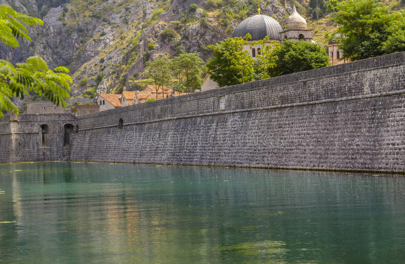Old town Kotor. Kotor old town north defensive walls and Scurda river stock photography