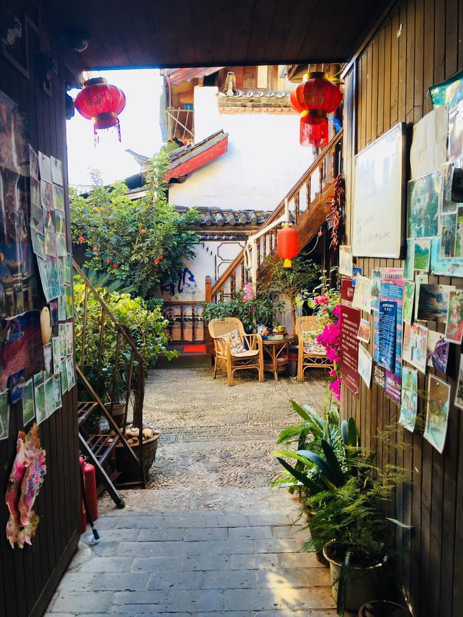 Old town of Lijiang. Full of colored houses, with plants and flowers royalty free stock photos