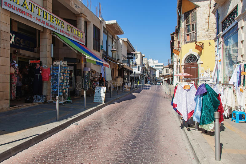Old town. Limassol Lemesos, Cyprus. Limassol Lemesos, Cyprus - July 17, 2015: Narrow street of an old town and shops for tourists royalty free stock image