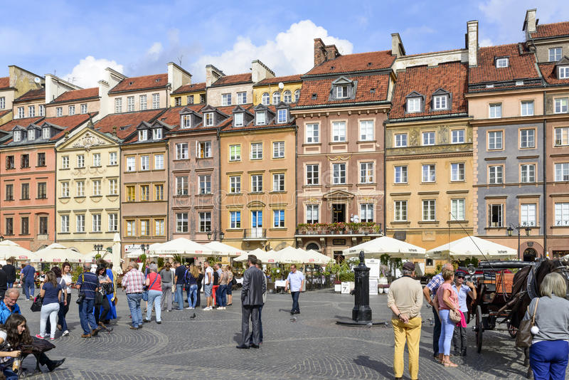 Old Town Market Place in Warsaw. Tourists from all over the world visit the Old Town Market Place on 16 September 2015 in Warsaw, Poland royalty free stock photo
