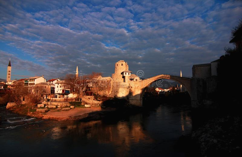 Old Town, Mostar, Bosnia. Birds flying over river, early morning on the old town of Mostar, Bosnia stock photo