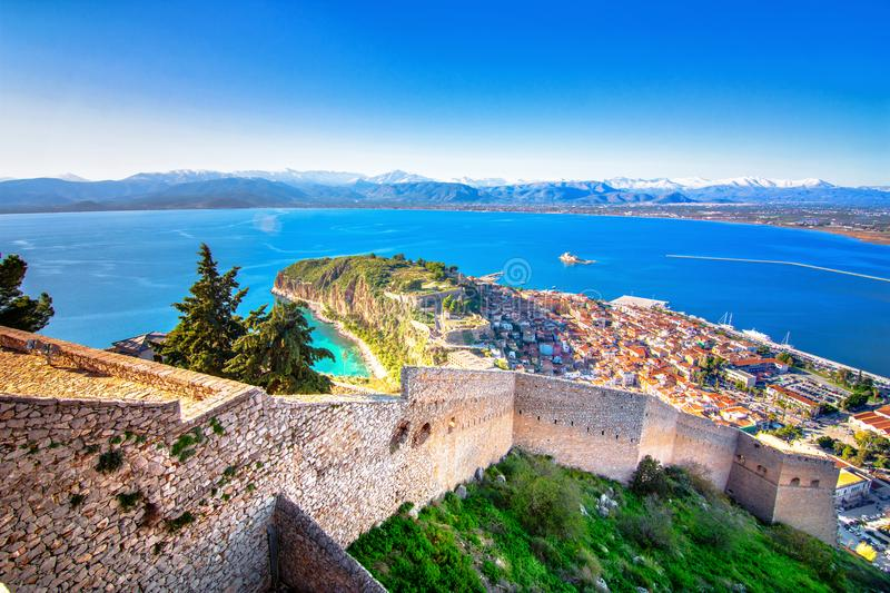 Old town of Nafplion in Greece view from above with tiled roofs, small port and bourtzi castle on the Mediterranean sea. royalty free stock photo