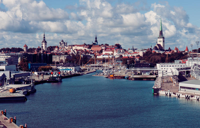 Old Town and sea port harbor in Tallinn, Estonia. Vintage tinted snapshot of the Old Town and sea harbor in Tallinn, Estonia. Talinn sityscape stock image
