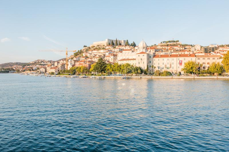 Old town of Sibenik, Croatia. Waterfront view from the sea. On the old town with cathedral and fortress royalty free stock photography