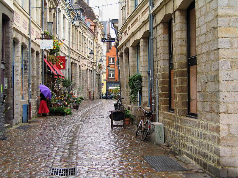 Old Town Street in Lille on a Rainy Day, France. View of the cobble-stoned Rue de Peterinck in the historic old town of Lille in northern France on a rainy late stock photo