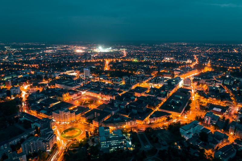 Old town Timisoara in the night. Old town Timisoara with beautiful city lights at blue hour - aerial view taken by a professional drone stock photo
