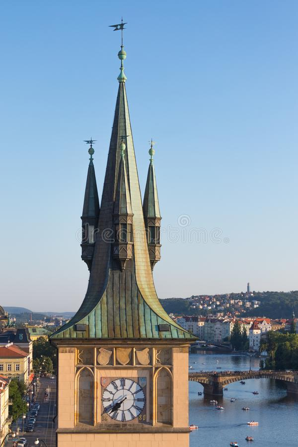 Old town water tower with Legions Bridge on Vltava river in background, Prague.  stock photo
