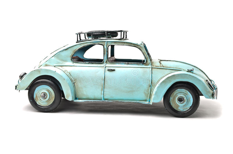 Old toy car. Old light blue toy car over white background stock image