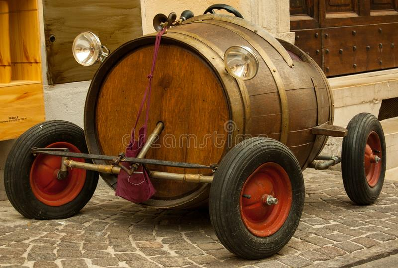 Old toy car with barrel and red wheels stock photo