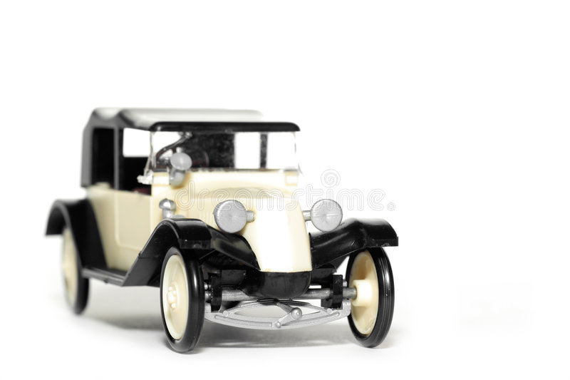 Old toy car Tatra 11 Faeton. Picture of a old plastic toy car Tatra 11 Faeton 1924. Czech toy from my brothers toy collection. Made in the 1970's. Isolated on royalty free stock images
