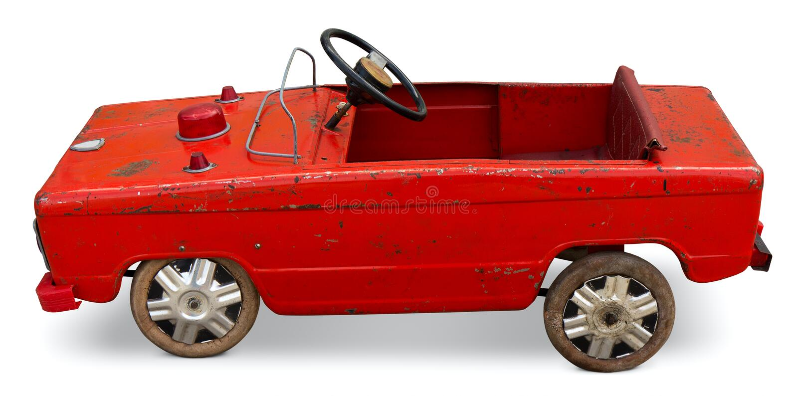 Old toy pedal car. Isolated. Clipping path included stock photo