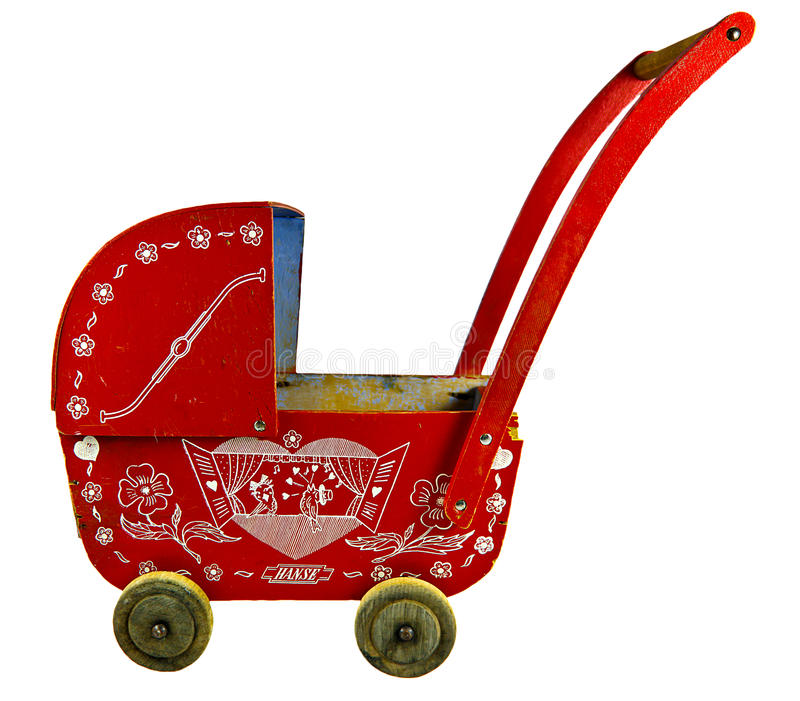 Old toy stroller. Out of wood. Isolated on white royalty free stock images