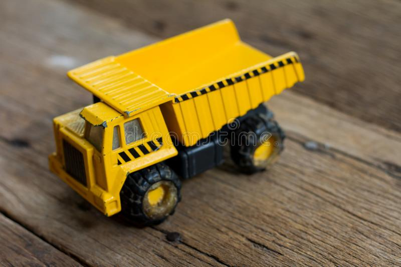 Old toy truck on wooden table. royalty free stock photo
