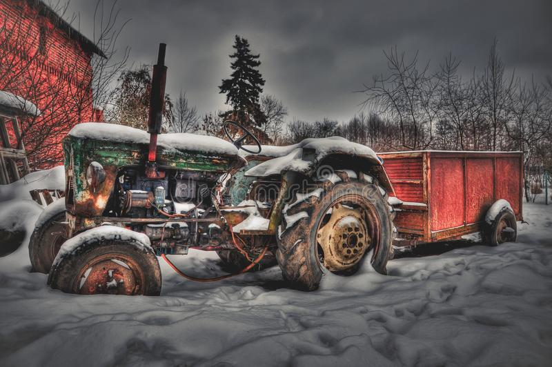 An old tractor in an abandoned farm stock photos