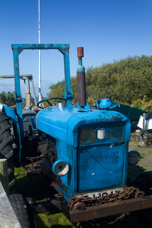 Old Tractor. On a farm near the sea royalty free stock images