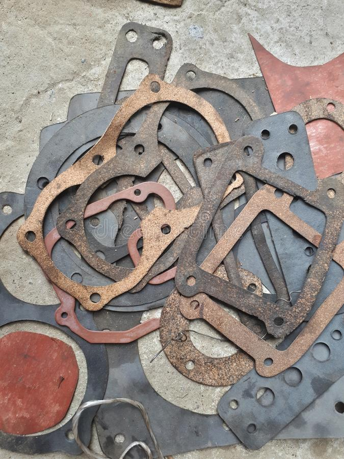 Old tractor gaskets. On the pile stock images