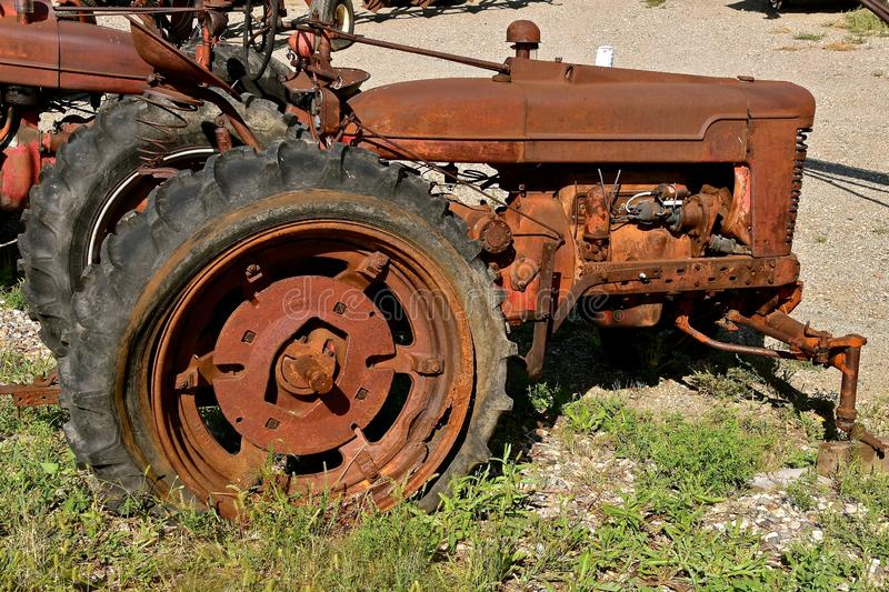 Old tractor missing front wheel stock images